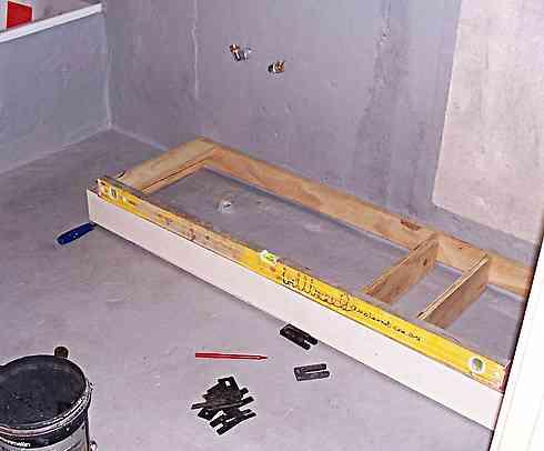 fitting bathroom cabinet plinth