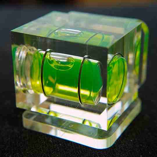 A tubeular spirit level set into a solid block of resin/plastic