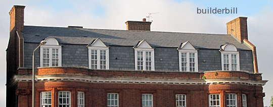 a gambrel roof with dormer windows.