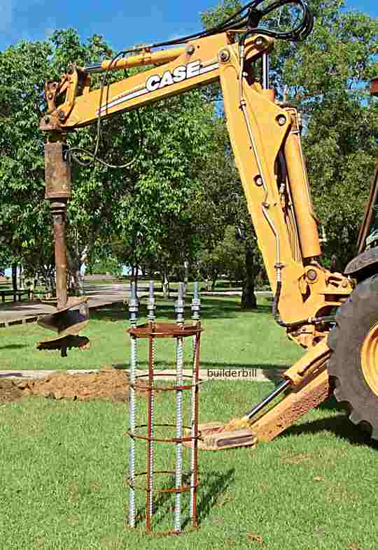 a backhoe mounted earth auger