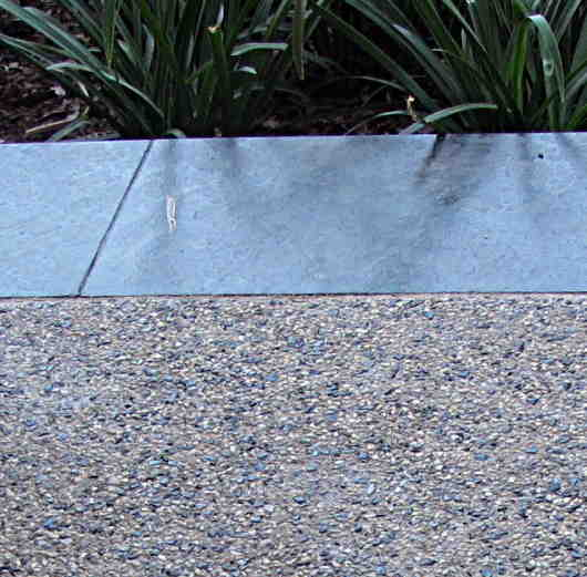 Exposed aggregate - A seeded exposed finish to a patio slab. The under  laying concrete may well use a standard mix with 20mm aggregate, but the  seeded ... - Exposed Aggregate,decorative Concrete How To