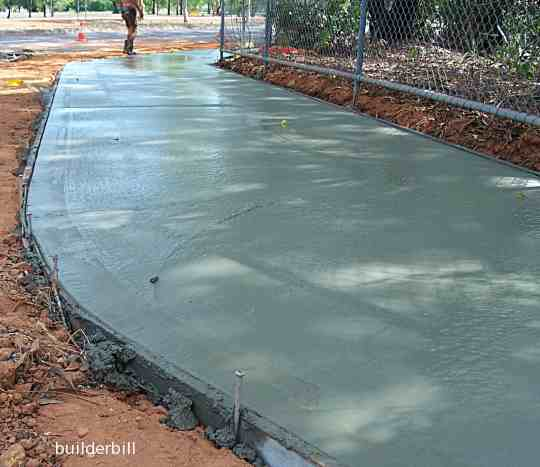a freshly laid concrete pavement.