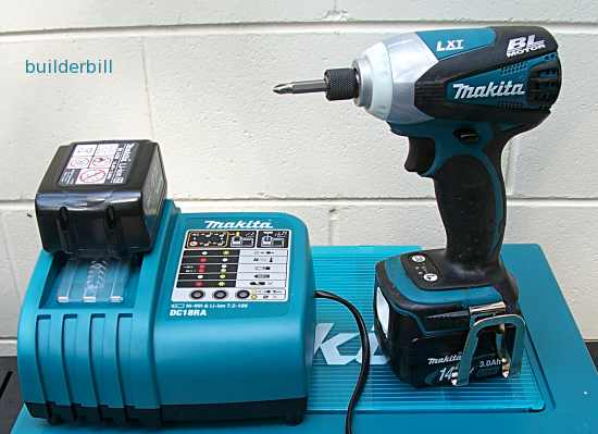 A cordless   impact screwdriver with battery charger and spare battery