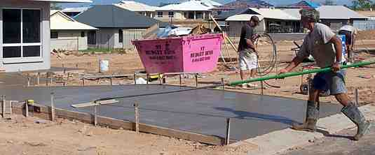 Using a bullfloat on a fresh concrete slab