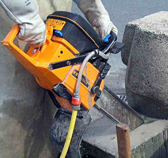 A concrete cutting chainsaw
