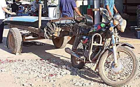 motorbike roofing transport in Cambodia