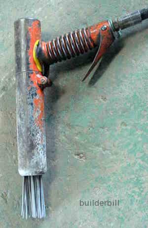 a needle scabbler