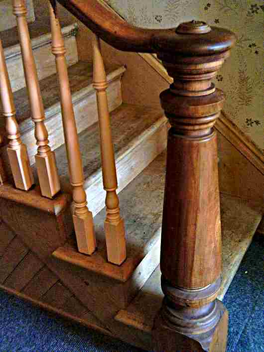 A timber newel post