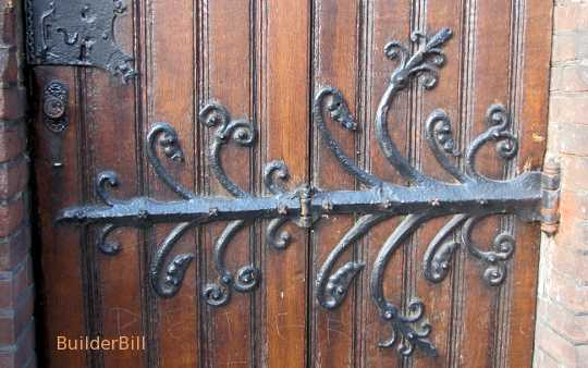 An ornate wrought iron hinge