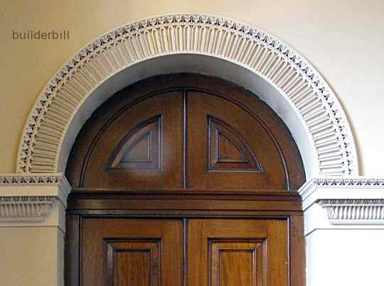 plaster archivolt to a timber doorway