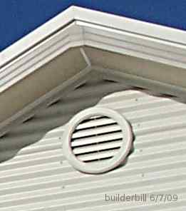 A small plastic gable vent