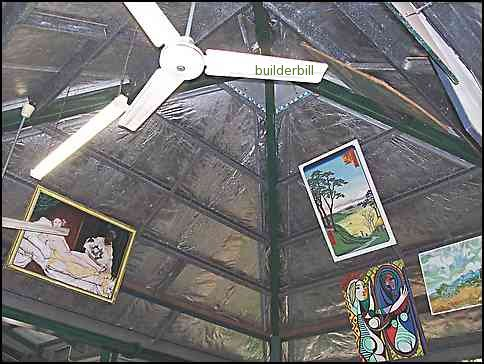 inside of an all steel roof showing hip beams,tie beams and stee puurlins