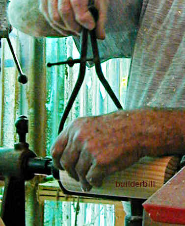 using spring callipers to check a wood turning