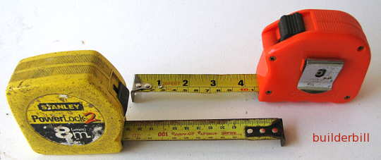 two builder's tape measures