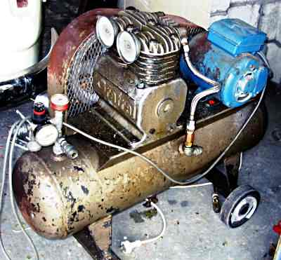 A twin cylinder portable air compressor