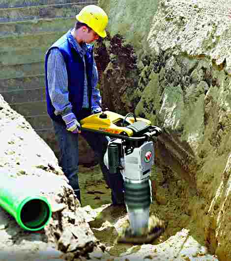 Doing what it does best, a wacker compacting a trench