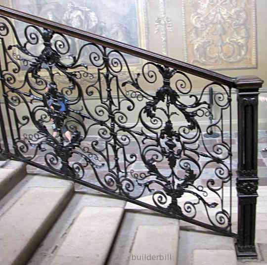 a fine wrought iron balustrade to a stair