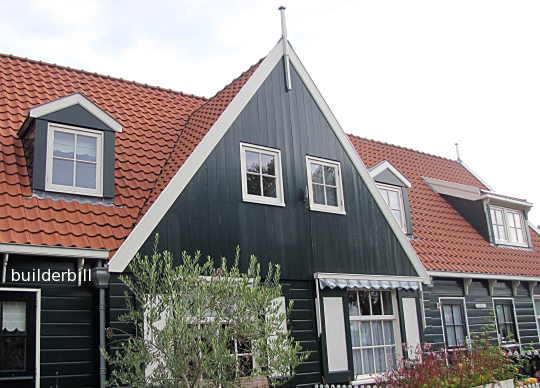 two gable dormers and a shed dormer