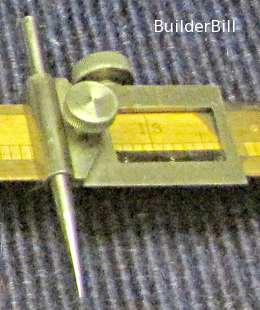 A close up of a beam compass