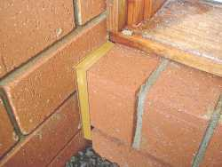 expansion joint around a sill.