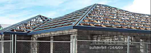 a hip roof under construction