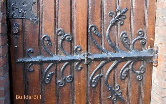 An ornate wrought iron hinge