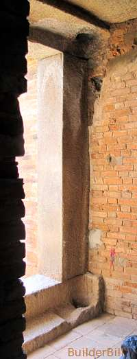 Old pivot holes are all that is left of a temple door
