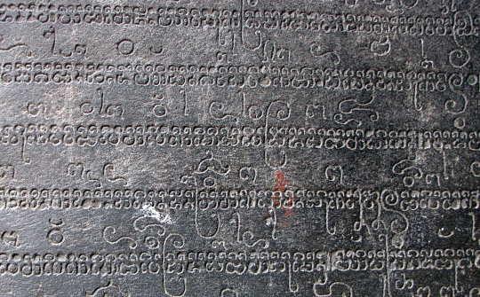 door reveal with sanskrit carving