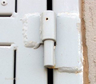 A weld on ball bearing hinge.